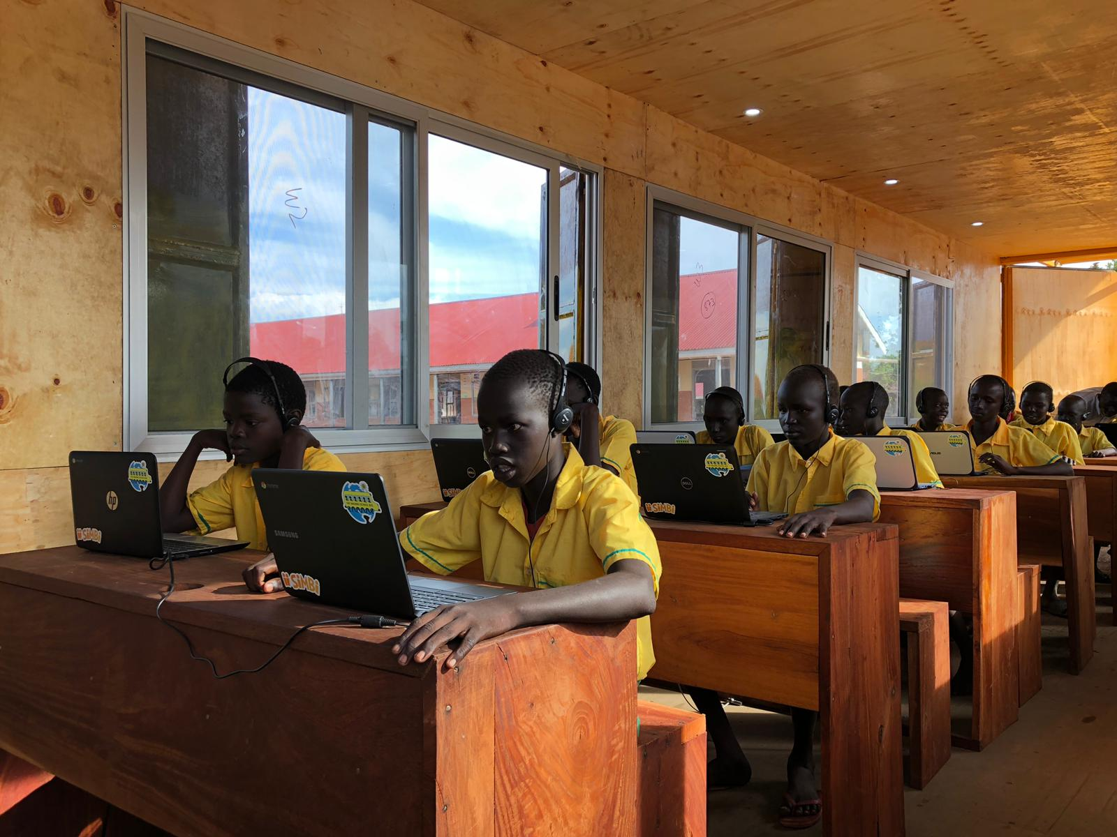 students in uganda using Simbi