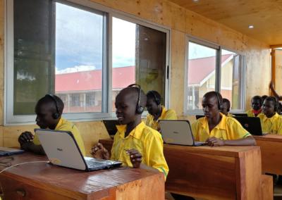 Students reading at Twaijiji Primary School